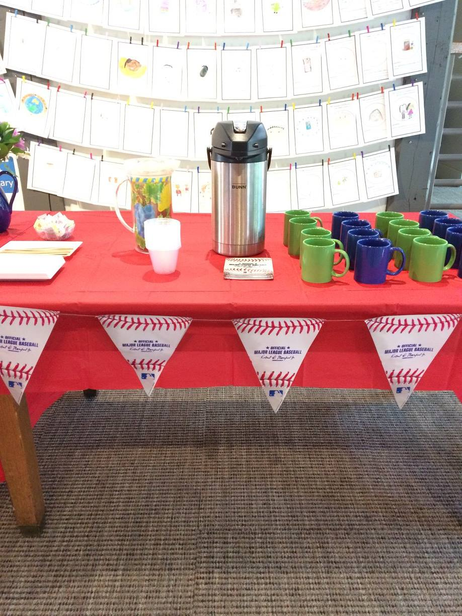 Table with baseball pennants and coffee